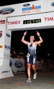Jimmy Sobeck Jr. crosses the finish line at the Ironman Triathlon in Panama City, Fla.