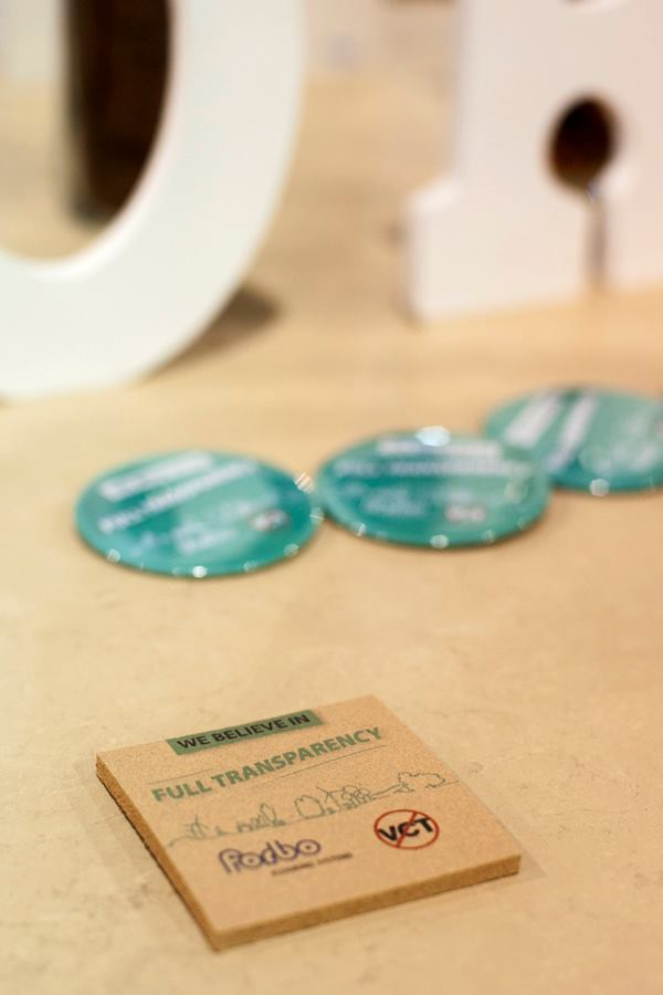 Cards and pins celebrating a movement toward material transparency were seen at Forbo Flooring Systems and Teknion.