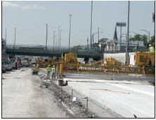 Walsh Construction removed and replaced 48 lane miles of concrete pavement on Chicago's Dan Ryan Expressway wedged between commuter trains and heavy traffic.