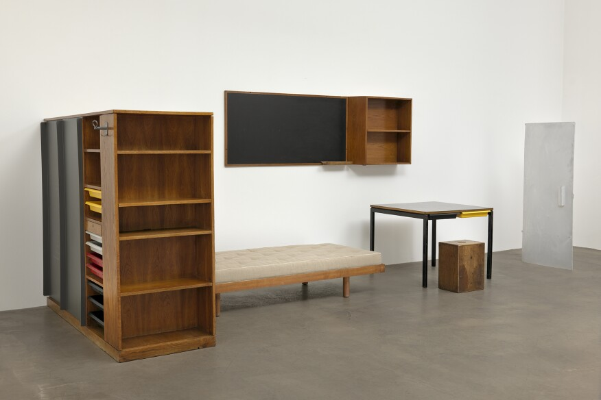 Another view of the dormitory furnishings from the Maison du Brésil by Charlotte Perriand, which are made out of wood, tubular steel, plastic, formica, fabric, and aluminum.