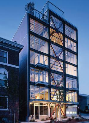 The eight units in the award-winning 1310 East Union Lofts in Seattle feature commercial storefront-style windows and concrete floors.
