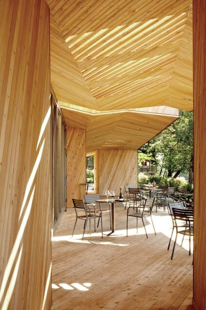 View of the outdoor seating area with its slatted canopy.
