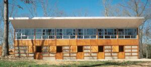 horsing around  EFCO's clear anodized commercial windows punctuate this Blackwell-designed barn house. The upper-level living spaces benefit from a full-length window wall conveying abundant light and panoramic views. According to Blackwell, the Monett, Mo.-based manufacturer had no problem creating the project's fenestration pattern, which mirrors the stall-door openings in the stables below. EFCO Corp., 417.235.3193; www.efcocorp.com