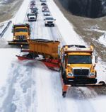 The TowPlow is toted behind a vehicle rather than in front. Its steerability gives the driver more control than similar snow-removal devices. Photo: TowPlow