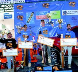 Participants took home more than $100,000 in cash and prizes. Sharing  the winners' platform were (from left), Toughest Tender Alfredo Garcia, Top  Craftsman and third place finisher Bill Morrisette, World's Best Bricklayer  Mike Boll, and second place finisher Jeff Burton.