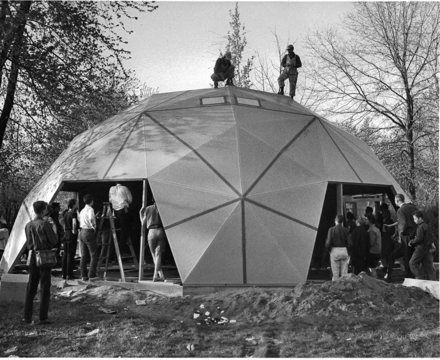 Construction on Buckminster Fuller's former geodesic dome residence in Carbondale, Ill., in 1960. The architect encouraged minimal material use in his structures.
