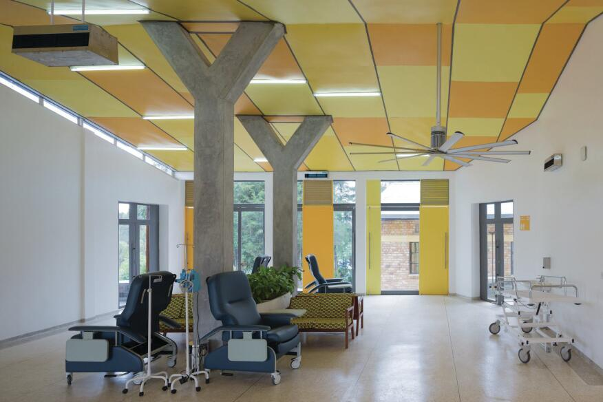 In the infusion room, patients can sit with family members in custom furniture that sits on SAJ floor tile while they receive their treatment. Large-scale doors can open to the outside to promote cross-breeze from the Big Ass Fans fixture installed overhead.