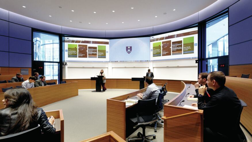 The 16 elliptical classrooms on the upper two levels are laid out in different orientations to accommodate the different styles of classes in the school of management.