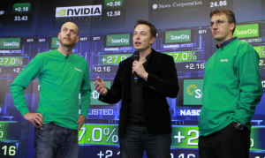 Founder & COO Peter Rive, Chairman Elon Musk , SolarCity Founder & CEO Lyndon Rive speak at the company's IPO at the NASDAQ stock exchange on December 13, 2012 in Manhattan, New York. SolarCity is a leader of distributed clean energy and will trade under SCTY. (Mark Von Holden/AP Images for SolarCity)