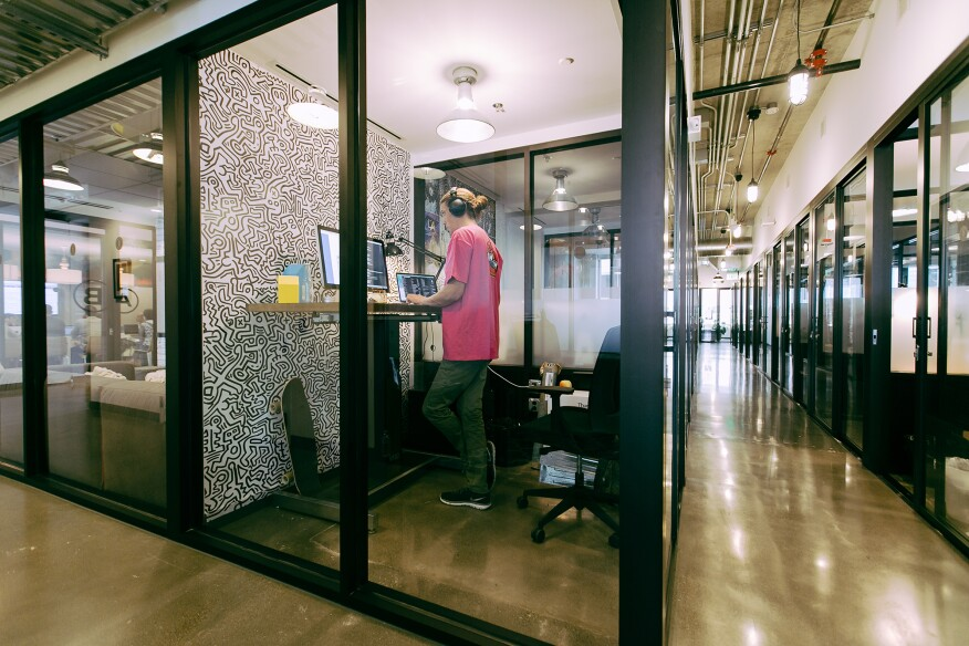 WeWork's scale means it also has the ability to influence product manufacturing. The company uses miles of aluminum storefront systems to delineate spaces. WeWork director of building research Jason Andersen said the company has designed a frame whose section requires 16 percent less aluminum than the current product—saving both shipping and material costs. The company is also experimenting with the thickness of the glass lites to modulate reverberation.