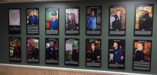 A wall at Hancock Lumber's HQ recognizes the employees of the year for each branch