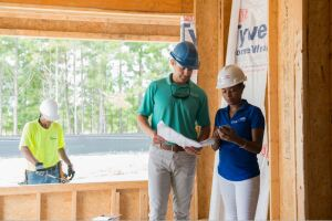 Millennials collaborating with builders