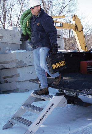 The TruckStairs three-step folding staircase secures to any 2-inch receiver hitch. Photo: New England Machine LLC