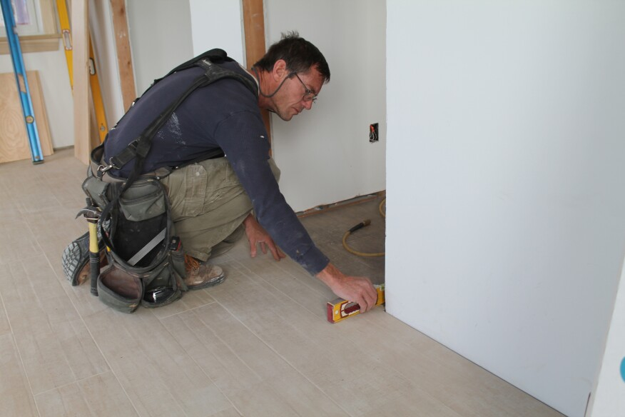 The final check is that the floor is level under each jamb leg. If it's sloped, the cut should be adjusted accordingly.