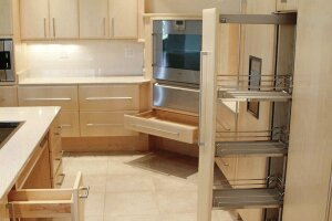 Pull-out storage shelves and easy grip handles make life easier in this universally designed kitchen.