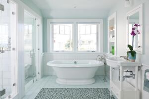 In this Cape Cod, Mass., bath designed by Hutker Architects and Eileen Peretz Interiors, a glass tile mosaic pattern adds interest underfoot.