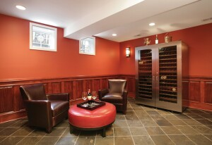 "No longer relegated to the garage or dark unfinished basement, modern ""man spaces"" may offer a unique niche for remodelers.  Spaces should have masculine design elements,and room for grown-up toys and visiting areas. Stainless steel, dark wood, and slate create a masculine feel in this wine tasting/cigar room."