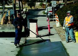 To minimize negative response to the inevitable disruption of installing new  sewer lines, Lake Havasu City is restoring all driveways and yards to their  original condition. Photo: AMEC