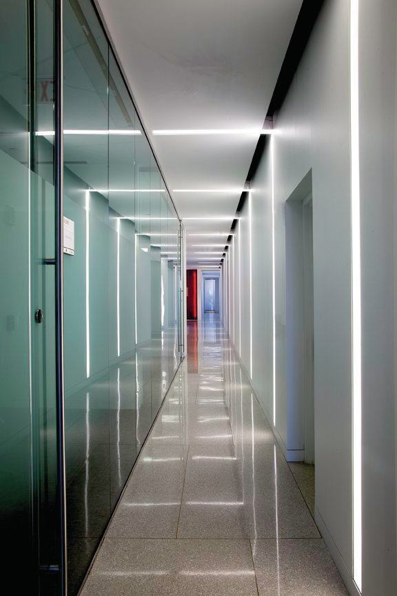 """A glass wall along one of the upper-level corridors provides a reflective surface for the lines of light to transform into """"light frames."""""""