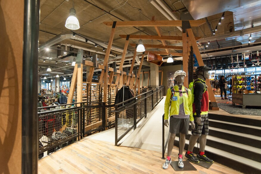 "The store's 50,000 products can overwhelm visitors so REI and CallisonRTKL broke up the floor with terraces and a mezzanine level. REI's Jared Pearce says the different platforms create ""a sense of an amphitheater,"" harking back to the concerts and sporting events held in the arena."