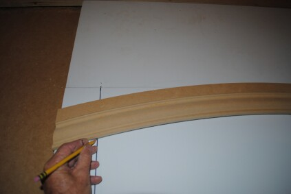 When installing an eyebrow arch with a finished floor below, it's easier to do the layout on a table so you can cut the length of the sides to fit at the end. First trace the arch onto the table or bench.