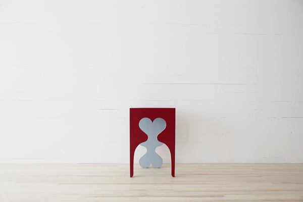 Herder's Puppy side table uses the cut-out of its front as a third leg.