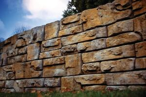 "Redi-Rock Ledgestone, a new retaining wall face from Redi-Rock International, gives structural walls a rugged, natural look. The stones can be used to build tall gravity walls; users can achieve more height with reinforcement. Middle blocks weigh 2400 pounds, measure 46"" by 41"" by 18"" high, and offer 5.75 square feet of face. redi-rock.com"