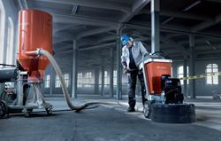 A heavy-duty industrial vacuum system helps protect workers against harmful dust inhalation on large floor-grinding projects.