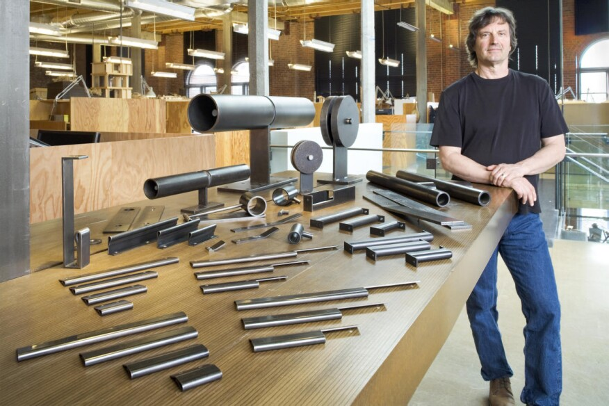 Seattle-based architect Tom Kundig stands with products from his line of interior hardware, furniture, and, most recently, luminaires.