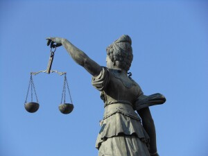 Scales of Justice (Photo courtesy of Michael Coghlan via the Creative Commons License)