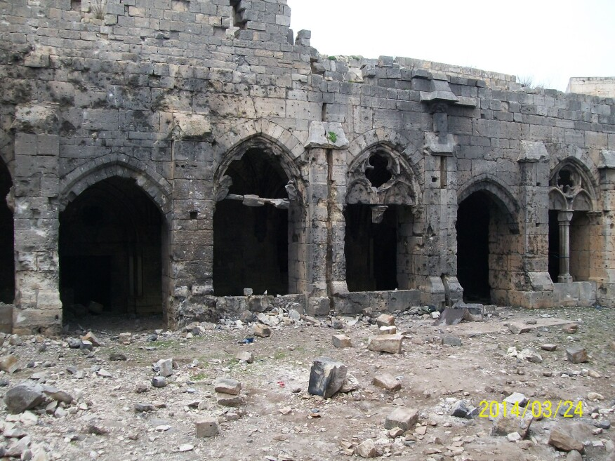 Crac des Chevaliers' exterior as of 2014, which is blackened and damaged from the explosions.
