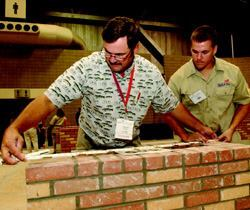 Porter Soley measures his son Daniel's completed composite project at the SkillsUSA  competition in Kansas City.