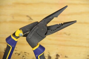 The pliers have a cutter, wire strippers, and a spanner--the notches across from the cutter that can be used to grasp nuts and bolts as if the tool were a combo wrench or pair of regular pliers. The jaws are spring loaded; that yellow thing in from the grip is for locking the jaws closed.