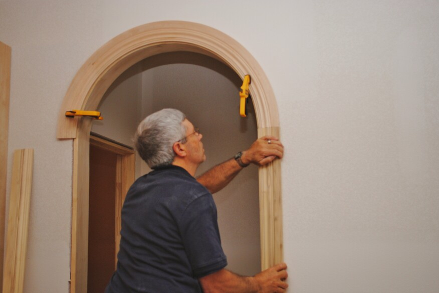 After cutting the circle arch, clamp it back in place and make the cuts on the side jambs. Those cuts should be square to the trim (parallel to the floor).