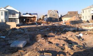 Streets are destroyed, homes are severely damaged or even obliterated. But full-time residents are determined to return, and chafing at the perceived delays.