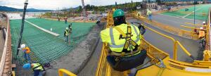With an inspiring view of the 2-mile-long Sandpoint Bridge spanning Idaho's Pend Oreille River, Winkler crews place and finish deck slabs using a bridge deck paver. The Highway 95 bypass project encompasses several overpasses.