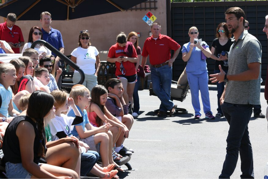 Michael Phelps speaks to approximately 30 children at a pool school held at Presidential Pools in Gilbert, Ariz.