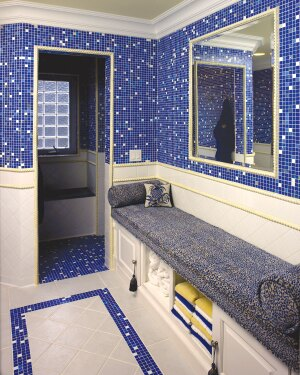 Perfect Fit Remodeler John Newmyer is a believer in the usefulness and convenience of bathroom benches, which can be set between two walls, such as this one, or designed to be freestanding.