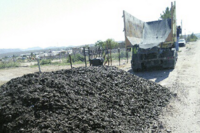 Repairing Roads With Recycled Shingles
