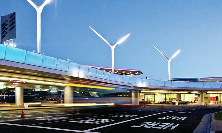 The color-changing light ribbon along the roadway edge is synched with the light pylons at the entry to LAX.