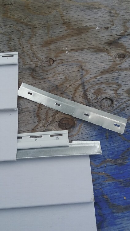 There are two different ways to reconnect separated panels. The first method is cutting a strip off a metal starter strip and inserting it into the lower locking strip to engage the separated panel at a lower level.