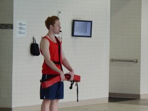 Man and machine: A lifeguard at the Decatur Family YMCA in Dacatur, Ill. stands at the ready. The facility installed an early-warning drowning detection system from Poseidon. When the system detects danger, an alarm sounds and the guard can locate the victim on the monitor seen in the background.