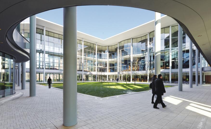 The north and south walls of the central courtyard feature undulating curves that reflect the elliptical classroom spaces within.