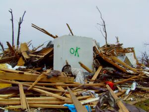 A Joplin resident survived the 2011 tornado by hiding in this Twister Safe steel storm shelter, as the building around it was reduced to splinters.