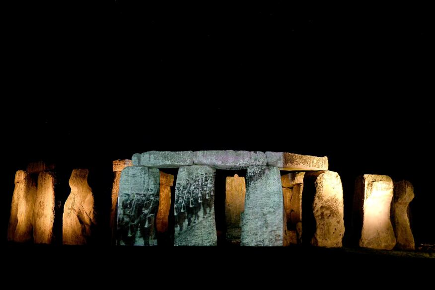 """Video of World War I soldiers is projected on the rocks at the Stonehenge monument in England. The installation is part of a new exhibition opening Wednesday, """"Soldiers at Stonehenge: Salisbury Plain and the journey to the First World War,"""" that looks back at the site when it was military training grounds."""