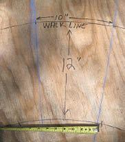 Figure 3. Snap chalk lines between the center point and two adjacent walkline tread marks to outline a tread. Verify that the minimum tread width is at least 6 inches.