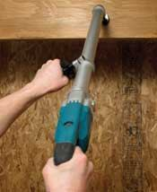 Using an angled extension, like on this Makita, allows for safe joist boring with both feet on the ground.