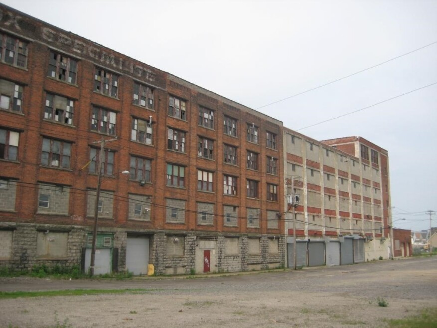 Before: The building was constructed in1901 for a paper-box manufacturer. The structure was added on to through the years, then occupied by a baseball-cap maker.
