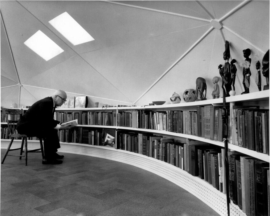 Buckminster Fuller in the loft, which featured a built-in, curved bookcase.