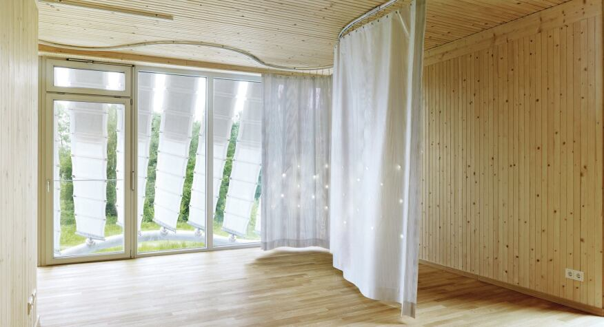 A moveable curtain hooked into a DC-powered track provides ambient light to the interior via embedded LEDs.